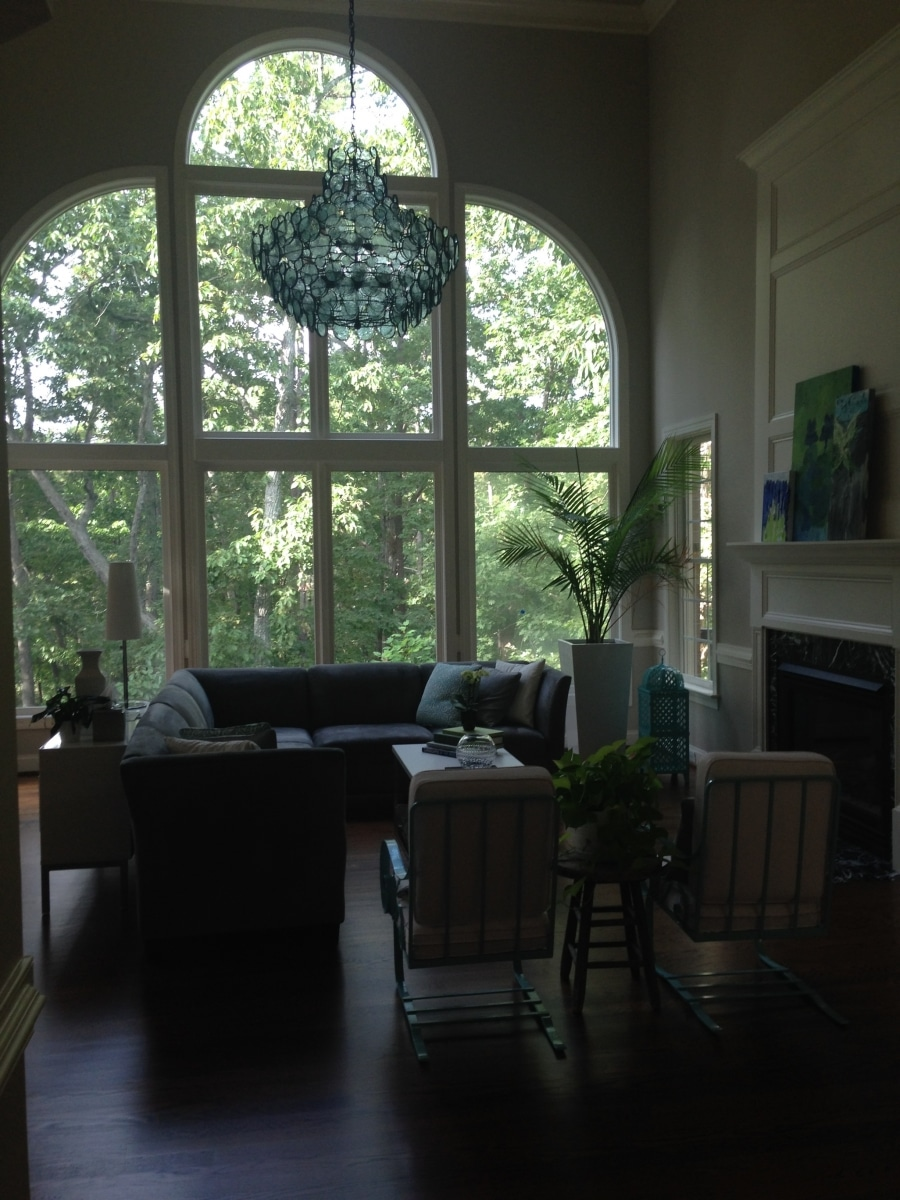 Living room with chandelier and decorative glass window